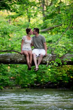 A couple sitting over a flowing river. Copyright Photographics Solution 2013