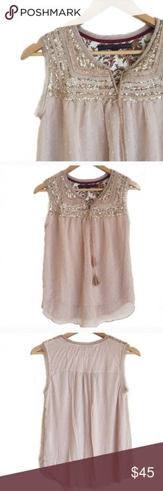 Anthropologie blush pink sequin top Gorgeous blush pink/nude top with sequins across the chest. One of the tassels lost its orange thread but you could either cut the orange one off or leave it - I promise no one has ever noticed. Anthropologie Tops Blouses