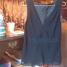 Black chiffon sleeveless evening top Pretty sleeveless chiffon top for evening. It is fully lined and has a side zipper. There are pleats at the shoulders and at the center front. Grosgrain ribbon encircles the waist. Very cute fit. I removed the tag because it was scratchy. I don't remember the brand    It will fit a medium or a large Tops