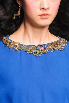 Gold embellishment on cobalt blue