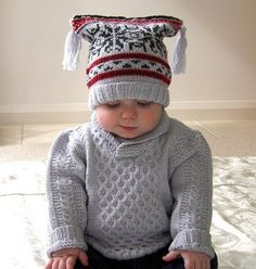 This fabulous little baby jumper has a very simple cable pattern, matching boots and jester style hat with a Nordic feel fair isle pattern. Great little outfit that I am sure once knitted, will get a lot of wear. This pattern comes with Fair Isle chart, and full instructions, and photo's on how to attach a shawl collar.