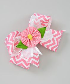 This happy hair bow instantly adds celebratory style. A clip this charming should be in every girl's arsenal of accessories.