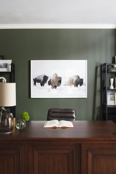 33 Chic Home Office Ideas - Captain Decor Office Desk Sleek and Modern home office + Sharkskin Benjamin Moore walls + dark green walls + traditional desk mixed with modern open shelving + buffalo photography + leather channel desk chair Office Lounge, Home Office Chairs, Home Office Space, Office Walls, Home Office Design, Home Office Decor, Home Decor, Office Desks, Decor Crafts