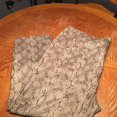 Tan and gray animal print slacks Tan and gray animal print slack with gold undertone Pants Trousers
