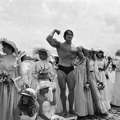 Arnold Schwarzenegger posing on the beach with starlets during the 1977 Cannes Film Festival. Well, yes. He knew he'd be something.