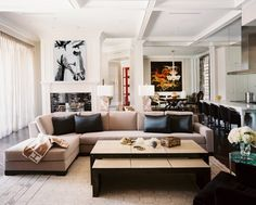A Glamorous Home Influenced by 1940's Design | Interior Design by Jamie Herzlinger of Jamie Herzlinger Interiors | Photography by Neil Landino | Modern Sanctuary | Family Room | Glamorous Family Room | Contemporary Family Room | Fireplace | Seating | Art | Modern Art