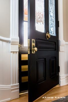 A makeover for this historic front door includes a coat of chic black paint and brass hardware. A downtown couple discover an Avenues gem and lovingly restore it with an eye to everyday comforts and avante-garde design—with a little help from Alice Lane. See more photographs of this project by following us on instagram @alicelanehome.com