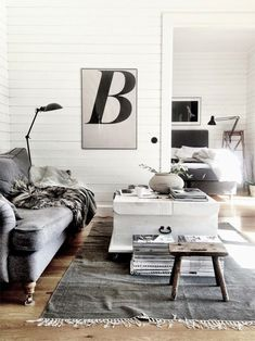 Grey, white, a little black and a little bit of wood. Equals a whole lot of gorgeous to me, although I'd love to see a lovely big tree in the corner or a massive bowl of tulips. Then I' be giving it a 10/10!