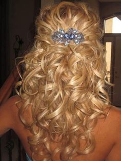 Pretty very curly medium-long shiny blond hair. Looks like a hair holder of some kind may have been used to while the hair was curled. ***** Referenced by Web Hosting With A Dollar (WHW1.com): WebSite Hosting - Affordable, Reliable, Fast, Easy, Advanced, and Complete.©