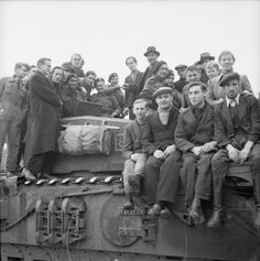 Dutch civilians cluster on a Churchill tank of 34th Tank Brigade, the first tank to enter Roosendaal, 30 October 1944.