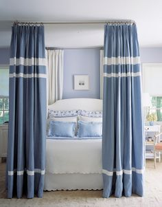 It's a great idea to attach curtain rods to your ceiling and use store-bought curtains to create an updated canopy.