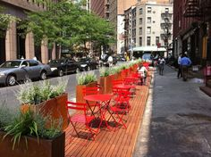 Pop-up park in NYC that takes up 4 parking spaces and creates 700 square feet of outdoor patio space.