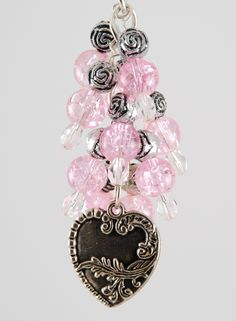 Pink Hearts Purskey use as a purse charm on clutch bags, wristlets, handbags, back packs, and more. You can also use it as a key chain