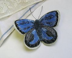 Embroidered butterfly brooch.  A pretty and unique brooch made using recycled fabrics.    It is my interpretation of a Silver-Studded Bluebutterfly