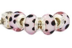 dalmatian glass beads with pink motif.