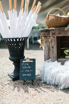 Umbrellas will make guests comfortable for a sunny or rainy outdoor wedding ceremony | Brides.com