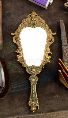 Photo about Vintage hand-held mirror at a flea market. Image of closeup, blank, vintage - 20037221