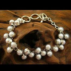 "Handmade Sterling Silver and Pearl Bracelet. Beautiful pearl cluster encased in sterling silver. Original and modern design illuminates any wardrobe. Measures Minimum length: 7"" L x 0.8"" W and weighs 32 grams. $279.99. Ships FREE within the U.S. Novica Jewelry Bracelets"