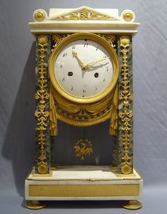 Antique French Directoire period mantel clock in ormolu & white & grey marble.   c.1790
