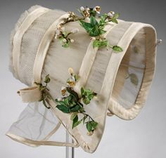Wedding bonnet made of silk tulle, crêpe, and imitation orange blossom, 1845.