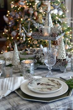 Winter table with birds, mercury glass, pine cones and snowflakes | homeiswheretheboatis.net