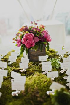 Use of moss on dining tables (used less sparingly though)