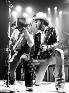 Dusty Hill and Billy Gibbons (right) from ZZ Top perform live onstage in Waterbury, Connecticut on the 'Texas World Tour' on 25th September 1975.