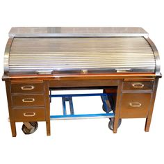Antique Steel Roll-Top Desk | From a unique collection of antique and modern desks at https://www.1stdibs.com/furniture/storage-case-pieces/desks/