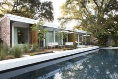 A globetrotting couple rebuild a Katrina-damaged residence by a famous midcentury New Orleans firm—on the very street where one of them grew up.