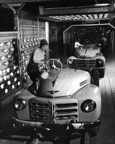 Japanese workers installing right side steering wheels in cars on an assembly line at a Toyota Motors plant. Photograph by Margaret Bourke-White. Vintage Cars, Antique Cars, Margaret Bourke White, Little Truck, Drive Time, Assembly Line, Toyota Cars, Car Advertising, Twin Turbo