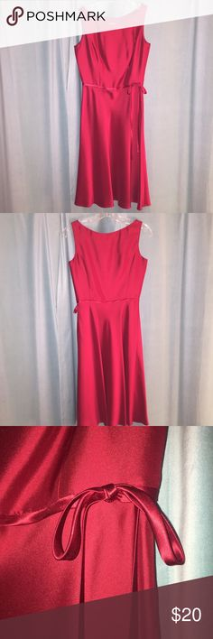 Ann Taylor Red Holiday Dress Gorgeous Ann Taylor Dress. Like new. Worn once. Beautiful satiny material. Deep red color. 💜💜 Make an offer!!! ⚡️⚡️⚡️Fast shipper⚡️⚡️⚡️ Ann Taylor Dresses Midi