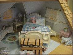 Diane Melcher's shabby cottage. That is my pink rose lying on the bed!