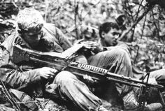 Private First Class Jerry D. Parker, fires his M-60 machine gun into a suspected enemy position while on a search and clear operation 10 miles northwest of Danang on July 7, 1969. This 19-year-old Marine is a member of Lima Company, 3d Battalion, 26th Marine Regiment.