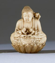 "IVORY NETSUKE By Tomosada. Depicting men climbing about on a large statue of Buddha. Signed. Height 2"" (5 cm)"