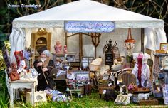 Miniature Antique Market Stall, including a shopper, in 1/12 scale.