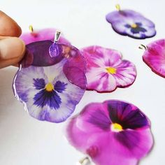 Handmade transparent purple pansy pendant coated in resin. What a wonderful flower! #resinjewelry