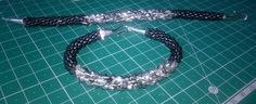 Made by Christine Cummings - it is 2 Kumihimo bracelets made from the Kleshna Kumihimo Crystal sparkle kit and plain black seed beads from the 100g duo beads bundle