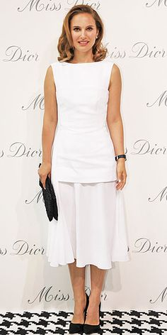 Last Night's Look: Love It or Leave It? | NATALIE PORTMAN | Looking straight out of a Miss Dior ad, the face of the brand poses in a summery white Christian Dior dress comprised of a structured top and a flowy sheer skirt, plus black accessories, at the Miss Dior exhibition in Shanghai.