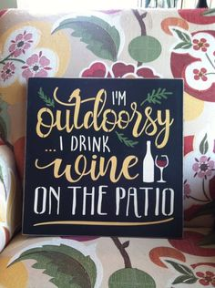 This is a solid wood sign that measures 12 x 12 with keyhole hanger. The sign reads Im Outdoorsy, I Drink Wine on the Patio. Sign can also be made to read porch or deck. The sign can also be made to read beer instead of wine.  The sign shown is painted in black letters have been stenciled in ochre and cream but also looks great in many colors including a burgundy background, an antique white background and black with white lettering for a chalkboard look. It would look great in almost any…