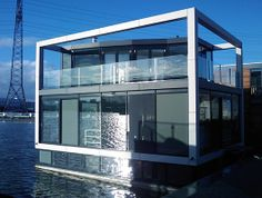 """Sooo....this is an actual house that exists, created by a Dutch developer called Dutch Docklands. They want to make these things in Biscayne Bay in Miami. Just houses. Floating in the water. They want to buy up water space to build """"floating communities"""". Hmmmm....."""