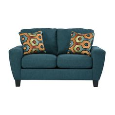 The downtown vibe of this loveseat is equally at home in any zip code. Comfortable, thick cushions and wide track arms accentuate the clean lines. Soft and inviting upholstery is dressed up with two colorful decorative pillows.