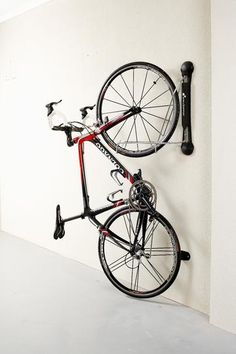 wall mounted bike rack that allows you to swivel the bikes nearly flat against the wall when not using--space saver for multi bike storage--we need this!