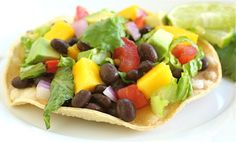 Black Bean and Mango Tostadas - Some of my favorite meals are the simple ones. Black bean and mango tostadas are at the top of our list when it comes to easy dinner recipes. Veg Recipes, Dairy Free Recipes, Other Recipes, Easy Dinner Recipes, Mexican Food Recipes, Whole Food Recipes, Great Recipes, Vegetarian Recipes, Favorite Recipes