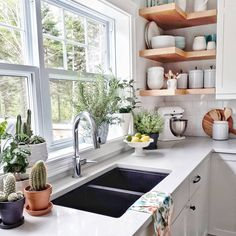 Stunning modern farmhouse kitchen with lots of white and wood shelves in the corner