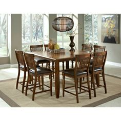 Arlington 9-Piece Counter-Height Dining Set from Costco $1699.  60x42 without leaf.  60x60 with leaf