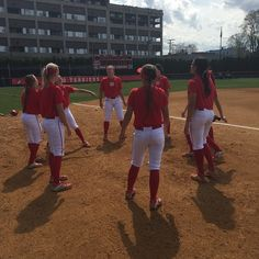 BU Softball sports the scarlet and white on a sunny spring home game.
