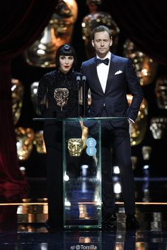 Tom Hiddleston and Noomi Rapace onstage presenting the Best Film Award during the 70th EE British Academy Film Awards (BAFTA) at Royal Albert Hall, London 12.2.2107 From http://tw.weibo.com/torilla/4074704971397280