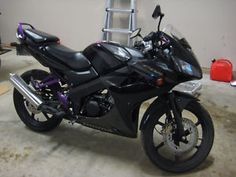 Bought my first motorcycle... Honda CBR 125 CC. Purple and black because, you know...