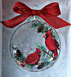 Glass Christmas ornament with cardinals inside that have been stamped and hand colored