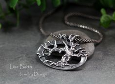 Here is my vision of a Tree of Life pendant.  The branches make the bail as they grow over to the other side and connect with a fully formed back of the tree.  This was done using fine silver metal clay, completely by hand, from an original drawing.  It was a design I had bouncing around inside my head for a while.  I am glad I finally had time to make it--Lisa Barth